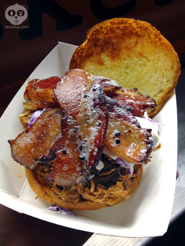C&S Brisket Bus Pulled BBQ sandwich with black pepper bourbon bacon